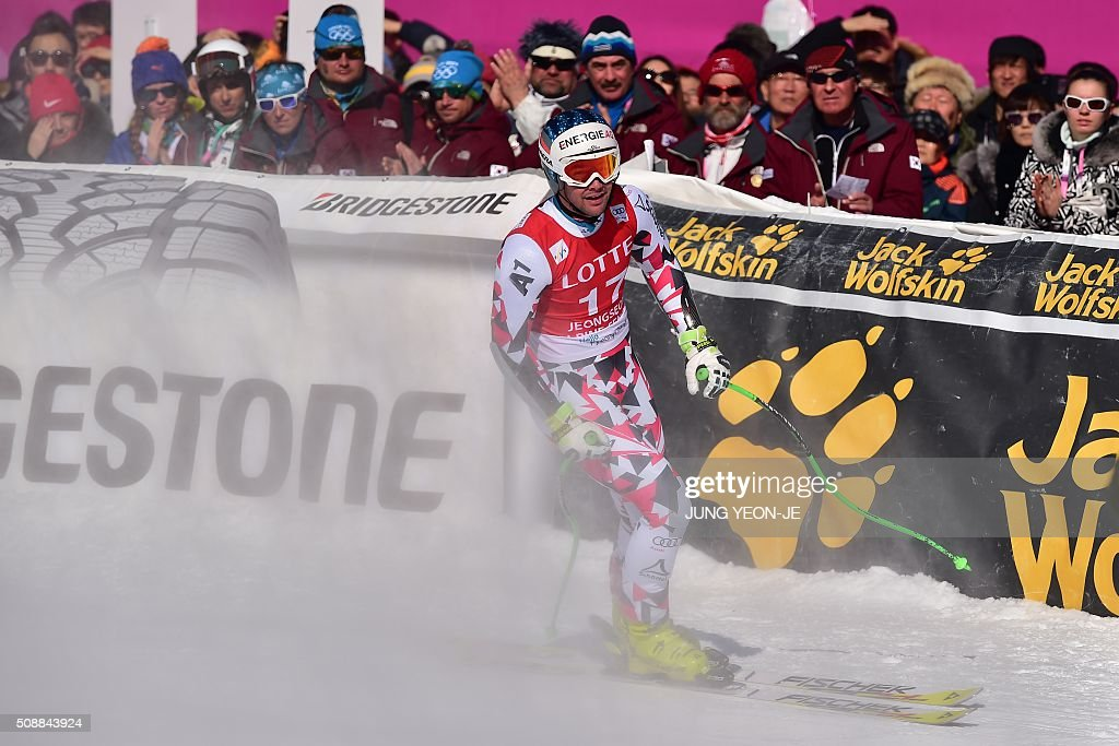 Vincent Kriechmayr of Austria arrives at the finish line during the 8th men's super G event at the FIS Alpine Ski World Cup at the Jeongseon Alpine Centre in Jeongseon county, some 150 kms east of Seoul, on February 7, 2016. The FIS Ski Men's World Cup runs from February 6 to 7 and is the first official test event for the Pyeongchang 2018 Winter Olympics. AFP PHOTO / JUNG YEON-JE / AFP / JUNG YEON-JE