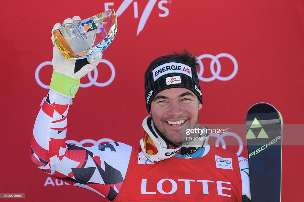 Vincent Kriechmayr of Austria holds his trophy on the podium after taking third place in the 8th men's super-G event at the FIS Alpine Ski World Cup in Jeongseon county, some 150 kms east of Seoul on February 7, 2016. The FIS Ski Men's World Cup runs from February 6 to 7 and is the first official test event for the Pyeongchang 2018 Winter Olympics. AFP PHOTO / Ed Jones / AFP / ED JONES