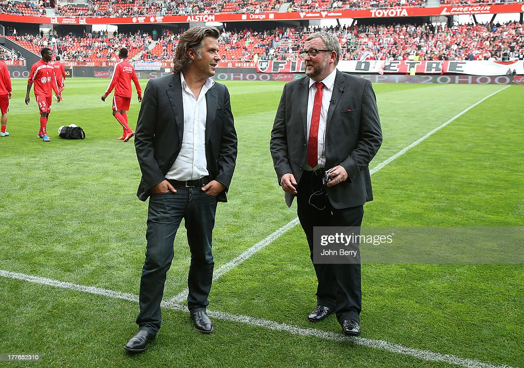 Vincent Labrune, president of Marseille chats with Jean-Raymond Legrand, president of Valenciennes FC before the French Ligue 1 match between Valenciennes FC and Olympique de Marseille OM at the Stade du Hainaut stadium on August 24, 2013 in Valenciennes, France.