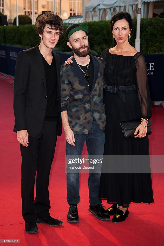 Vincent Lacoste, musician Woodkid and actress Geraldine Maillet arrive at the premiere of the movie 'Blue Jasmine' during the 39th Deauville American film festival on August 31, 2013 in Deauville, France.