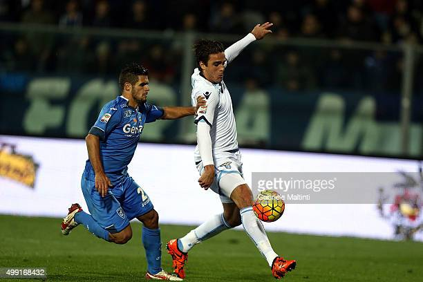 Vincent Laurini of Empoli FC battles for the ball with Alessandro Matri of SS Lazio during the Serie A match between Empoli FC and SS Lazio at Stadio...