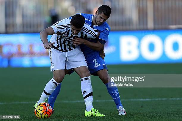 Vincent Laurini of Empoli FC battles for the ball with Alvaro Morata of Juventus FC during the Serie A match between Empoli FC and Juventus FC at...