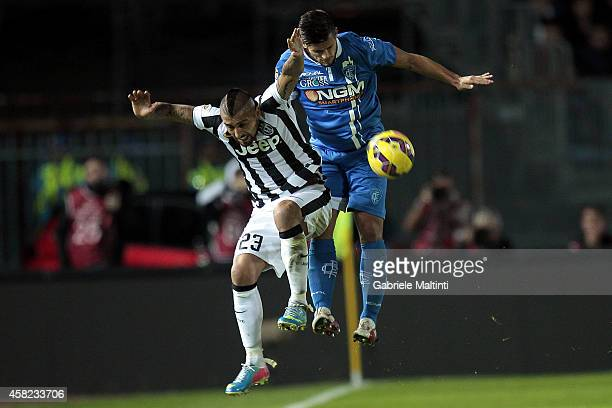 Vincent Laurini of Empoli FC battles for the ball with Arturo Vidal of Juventus FC during the Serie A match between Empoli FC and Juventus FC at...