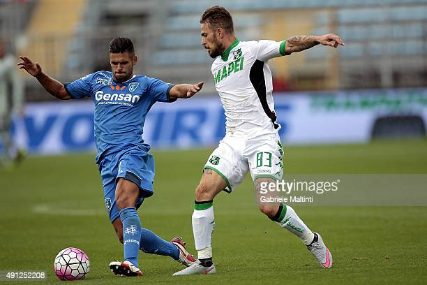 Vincent Laurini of Empoli FC battles for the ball with Federico Peluso of US Sassuolo Calcio during the Serie A match between Empoli FC and US...