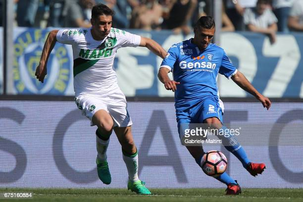 Vincent Laurini of Empoli FC in action agaist Federico Peluso of US Sassuolo during the Serie A match between Empoli FC and US Sassuolo at Stadio...
