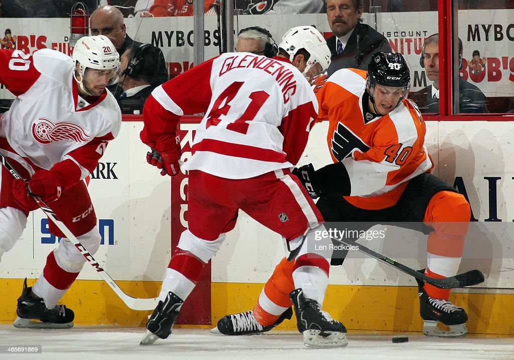 <a gi-track='captionPersonalityLinkClicked' href=/galleries/search?phrase=Vincent+Lecavalier&family=editorial&specificpeople=201915 ng-click='$event.stopPropagation()'>Vincent Lecavalier</a> #40 of the Philadelphia Flyers battles for the loose puck along the boards with <a gi-track='captionPersonalityLinkClicked' href=/galleries/search?phrase=Luke+Glendening&family=editorial&specificpeople=5650380 ng-click='$event.stopPropagation()'>Luke Glendening</a> #41 of the Detroit Red Wings on January 28, 2014 at the Wells Fargo Center in Philadelphia, Pennsylvania. The Flyers went on to defeat the Red Wings 5-0.