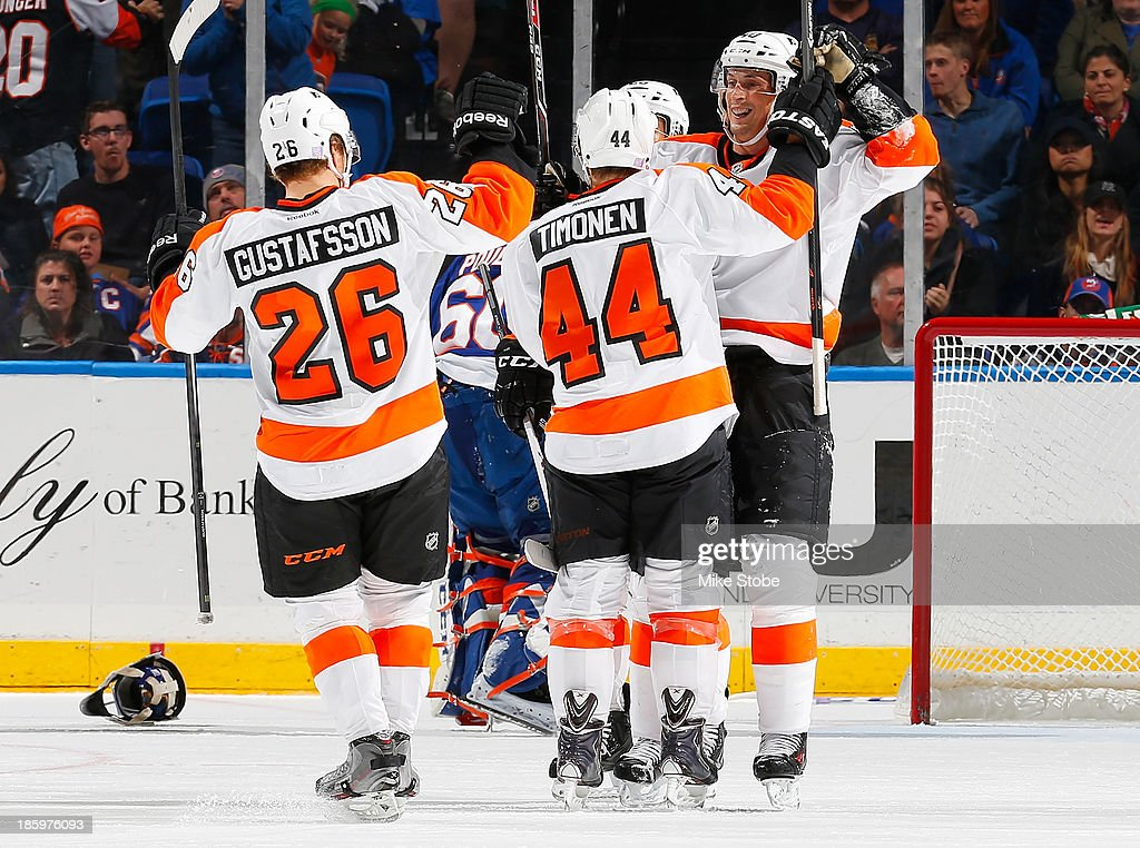 <a gi-track='captionPersonalityLinkClicked' href=/galleries/search?phrase=Vincent+Lecavalier&family=editorial&specificpeople=201915 ng-click='$event.stopPropagation()'>Vincent Lecavalier</a> #40 of the Philadelphia Flyers celebrates his third period goal with teammates <a gi-track='captionPersonalityLinkClicked' href=/galleries/search?phrase=Kimmo+Timonen&family=editorial&specificpeople=201521 ng-click='$event.stopPropagation()'>Kimmo Timonen</a> #44 and <a gi-track='captionPersonalityLinkClicked' href=/galleries/search?phrase=Erik+Gustafsson+-+Ice+Hockey+Player+-+Born+1988&family=editorial&specificpeople=10836949 ng-click='$event.stopPropagation()'>Erik Gustafsson</a> #26 against the New York Islanders at Nassau Veterans Memorial Coliseum on October 26, 2013 in Uniondale, New York. The Flyers defeated the Islanders 5-2.