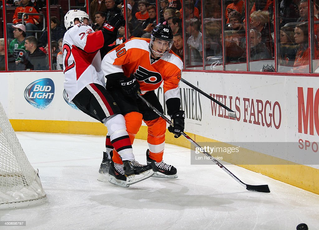 <a gi-track='captionPersonalityLinkClicked' href=/galleries/search?phrase=Vincent+Lecavalier&family=editorial&specificpeople=201915 ng-click='$event.stopPropagation()'>Vincent Lecavalier</a> #40 of the Philadelphia Flyers checks <a gi-track='captionPersonalityLinkClicked' href=/galleries/search?phrase=Erik+Condra&family=editorial&specificpeople=6254234 ng-click='$event.stopPropagation()'>Erik Condra</a> #22 of the Ottawa Senators off of the puck while skating behind the net on November 19, 2013 at the Wells Fargo Center in Philadelphia, Pennsylvania. The Flyers went on to defeat the Senators 5-2.