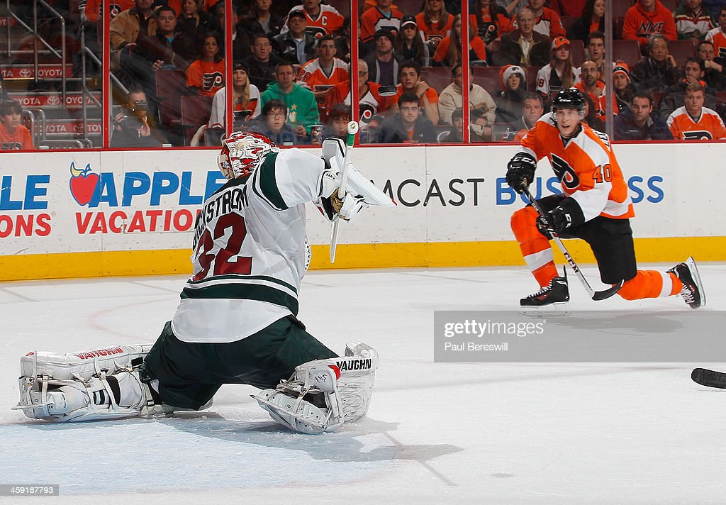 <a gi-track='captionPersonalityLinkClicked' href=/galleries/search?phrase=Vincent+Lecavalier&family=editorial&specificpeople=201915 ng-click='$event.stopPropagation()'>Vincent Lecavalier</a> #40 of the Philadelphia Flyers drops to a knee as he shoots on goalie Niklas Backstrom #32 of the Minnesota Wild who made the save during the second period of an NHL hockey game at Wells Fargo Center on December 23, 2013 in Philadelphia, Pennsylvania.