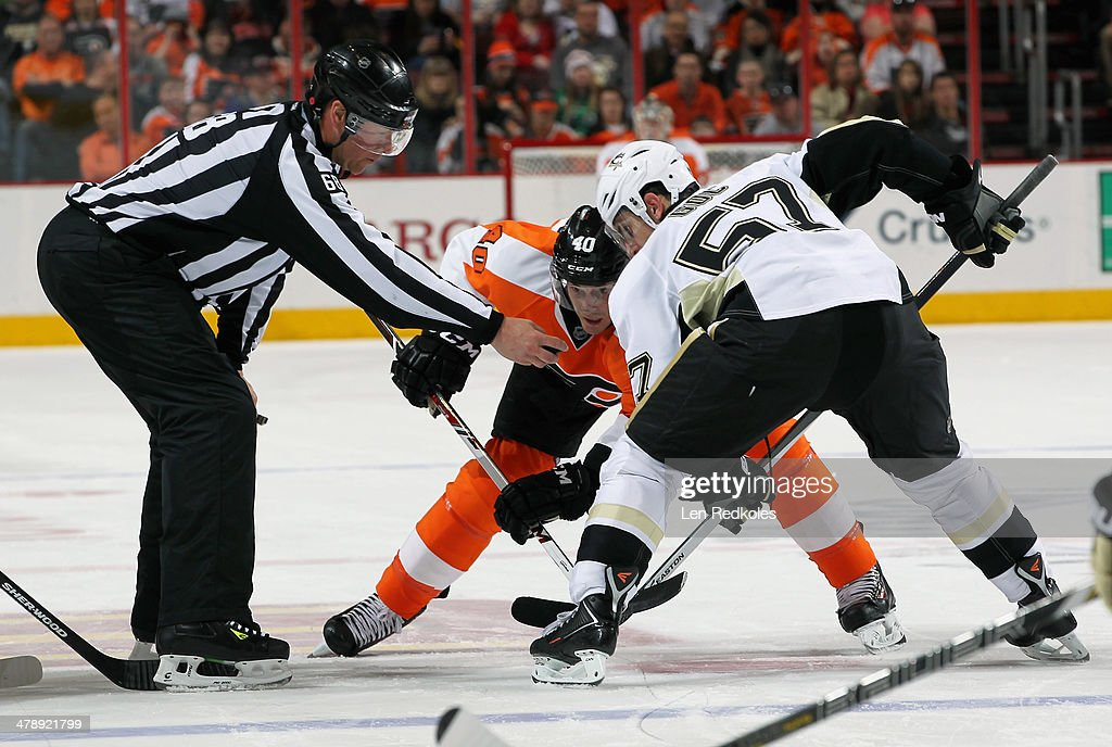 <a gi-track='captionPersonalityLinkClicked' href=/galleries/search?phrase=Vincent+Lecavalier&family=editorial&specificpeople=201915 ng-click='$event.stopPropagation()'>Vincent Lecavalier</a> #40 of the Philadelphia Flyers faces off with <a gi-track='captionPersonalityLinkClicked' href=/galleries/search?phrase=Marcel+Goc&family=editorial&specificpeople=541626 ng-click='$event.stopPropagation()'>Marcel Goc</a> #57 of the Pittsburgh Penguins on March 15, 2014 at the Wells Fargo Center in Philadelphia, Pennsylvania. The Flyers went on to defeat the Penguins 4-0.