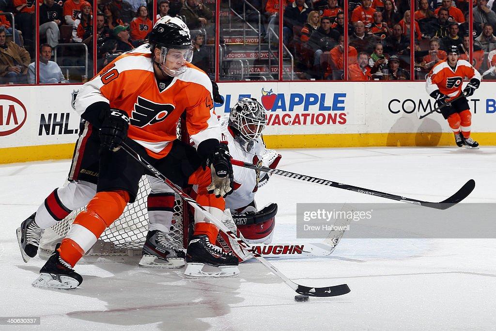 Vincent Lecavalier #40 of the Philadelphia Flyers gets pressure from Erik Karlsson #65 of the Ottawa Senators as he skates in on Robin Lehner #40 at the Wells Fargo Center on November 19, 2013 in Philadelphia, Pennsylvania.