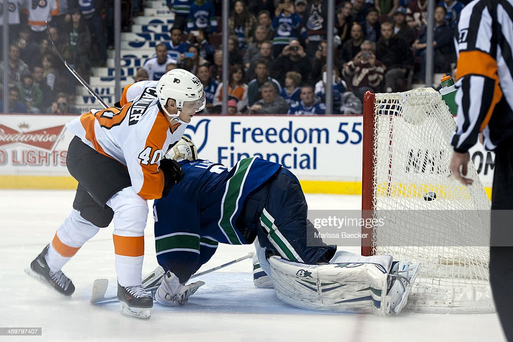 <a gi-track='captionPersonalityLinkClicked' href=/galleries/search?phrase=Vincent+Lecavalier&family=editorial&specificpeople=201915 ng-click='$event.stopPropagation()'>Vincent Lecavalier</a> #40 of the Philadelphia Flyers scores the first goal of the shoot out on Eddie Lack #31 of the Vancouver Canucks on December 30, 2013 at Rogers Arena in Vancouver, British Columbia, Canada.