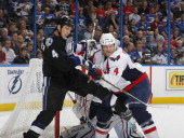 Vincent Lecavalier of the Tampa Bay Lightning battles for position against John Erskine of the Washington Capitals in front of the goal at the St...