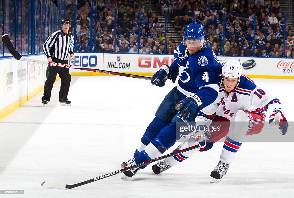 <a gi-track='captionPersonalityLinkClicked' href=/galleries/search?phrase=Vincent+Lecavalier&family=editorial&specificpeople=201915 ng-click='$event.stopPropagation()'>Vincent Lecavalier</a> #4 of the Tampa Bay Lightning battles for possession of the puck with <a gi-track='captionPersonalityLinkClicked' href=/galleries/search?phrase=Vincent+Lecavalier&family=editorial&specificpeople=201915 ng-click='$event.stopPropagation()'>Vincent Lecavalier</a> #18 of the New York Rangers during the third period of their game at the Tampa Bay Times Forum on February 2, 2013 in Tampa, Florida.