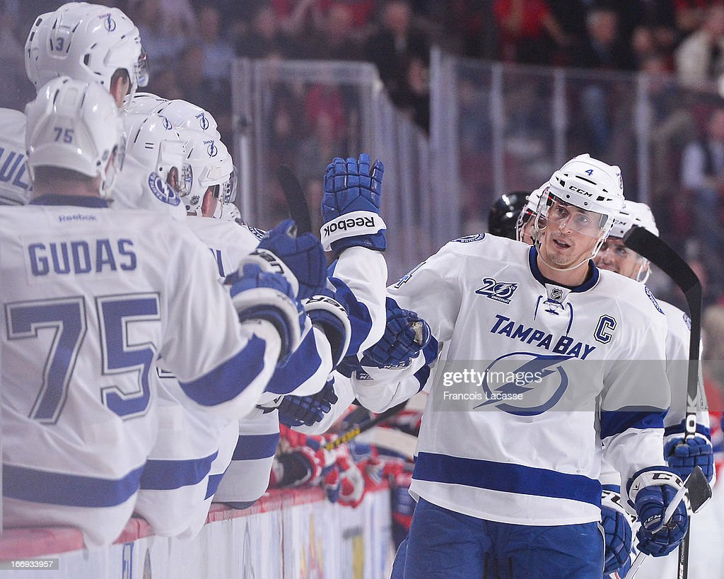 <a gi-track='captionPersonalityLinkClicked' href=/galleries/search?phrase=Vincent+Lecavalier&family=editorial&specificpeople=201915 ng-click='$event.stopPropagation()'>Vincent Lecavalier</a> #4 of the Tampa Bay Lightning celebrates a goal with temmates in NHL action against the Montreal Canadiens on April 18, 2013 at the Bell Centre in Montreal, Quebec, Canada.