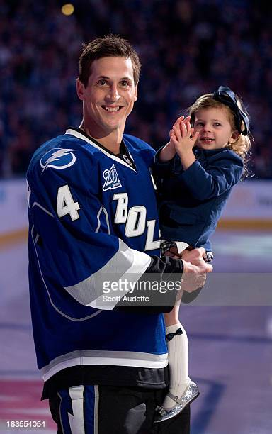 Vincent Lecavalier of the Tampa Bay Lightning celebrates with his daughter Victoria during his 1000th NHL game ceremony prior to tonights game...