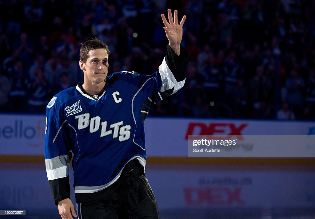 Vincent Lecavalier #4 of the Tampa Bay Lightning greets fans during his 1,000th NHL game ceremony prior to tonights game against the Ottawa Senators at the Tampa Bay Times Forum on January 25, 2013 in Tampa, Florida.