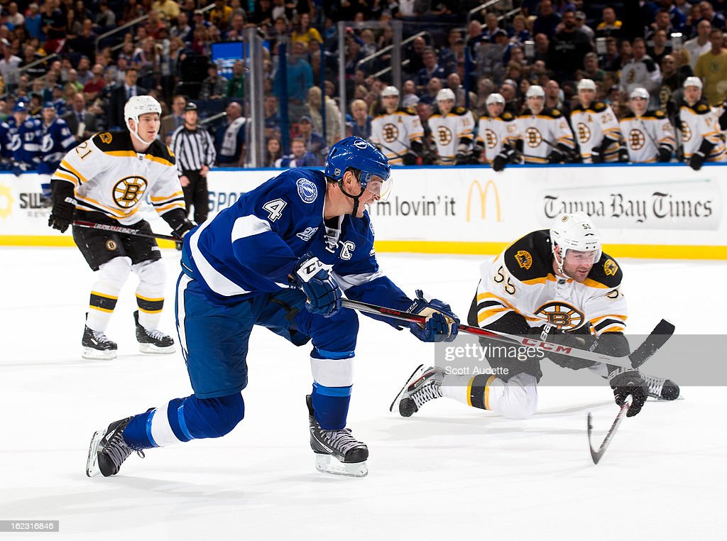 <a gi-track='captionPersonalityLinkClicked' href=/galleries/search?phrase=Vincent+Lecavalier&family=editorial&specificpeople=201915 ng-click='$event.stopPropagation()'>Vincent Lecavalier</a> #4 of the Tampa Bay Lightning passes the puck during the third period of the game against the Boston Bruins at the Tampa Bay Times Forum on February 21, 2013 in Tampa, Florida.