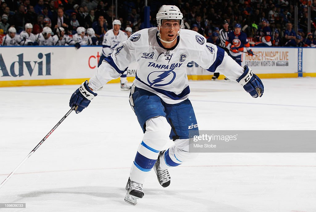 Vincent Lecavalier #4 of the Tampa Bay Lightning skates against the New York Islanders in his 1,000 career game at Nassau Veterans Memorial Coliseum on January 21, 2013 in Uniondale, New York.