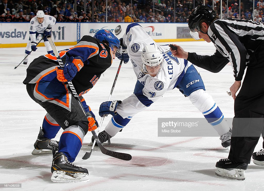 <a gi-track='captionPersonalityLinkClicked' href=/galleries/search?phrase=Vincent+Lecavalier&family=editorial&specificpeople=201915 ng-click='$event.stopPropagation()'>Vincent Lecavalier</a> #4 of the Tampa Bay Lightning skates against the New York Islanders at Nassau Veterans Memorial Coliseum on April 6, 2013 in Uniondale, New York. The Islanders defeated the Lightning 4-2.