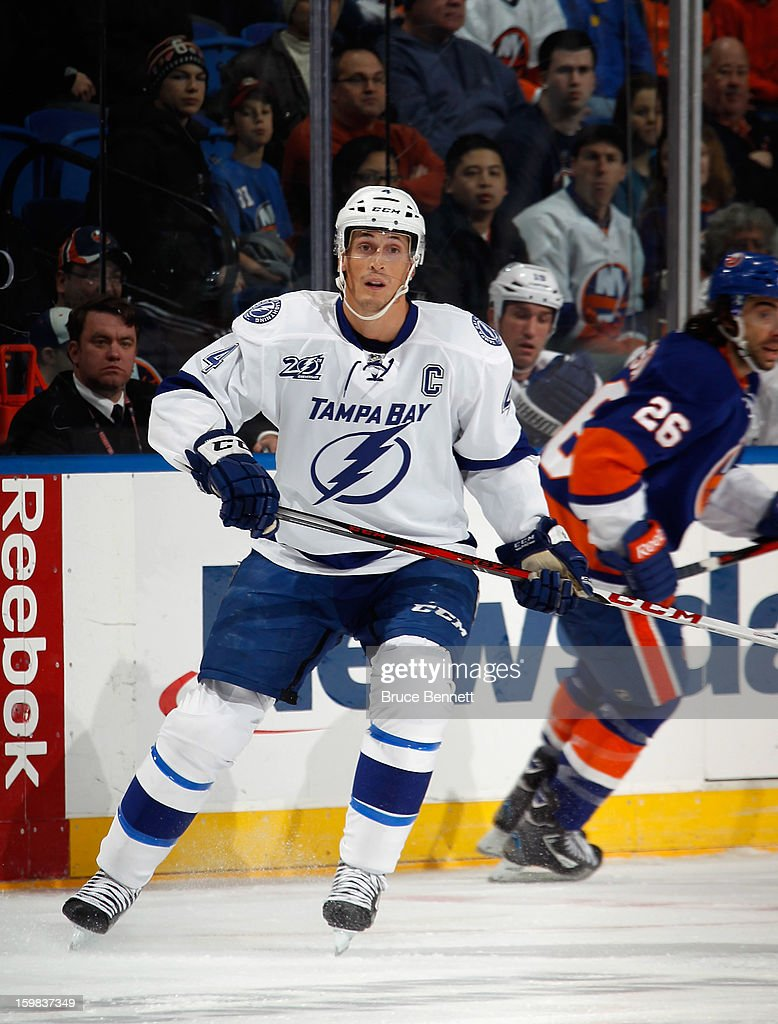 Vincent Lecavalier #4 of the Tampa Bay Lightning skates in his 1000th NHL game against the New York Islanders at the Nassau Veterans Memorial Coliseum on January 21, 2013 in Uniondale, New York.