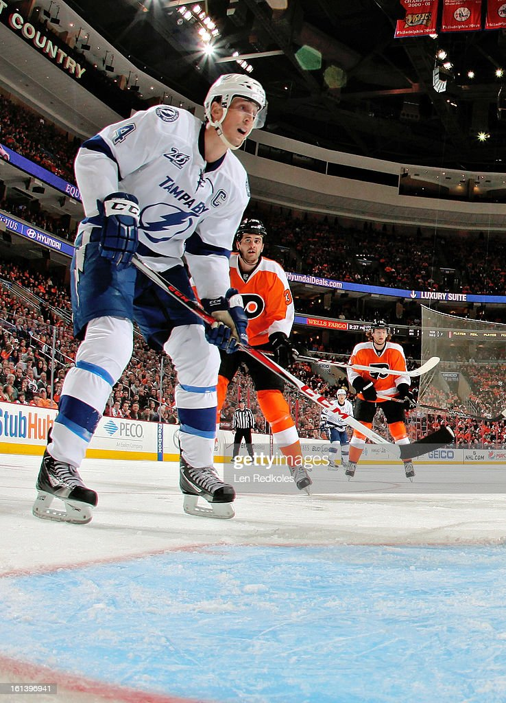 Vincent LeCavalier #4 of the Tampa Bay Lightning waits to deflect a shot on goal against Tom Sestito #32 of the Philadelphia Flyers on February 5, 2013 at the Wells Fargo Center in Philadelphia, Pennsylvania.