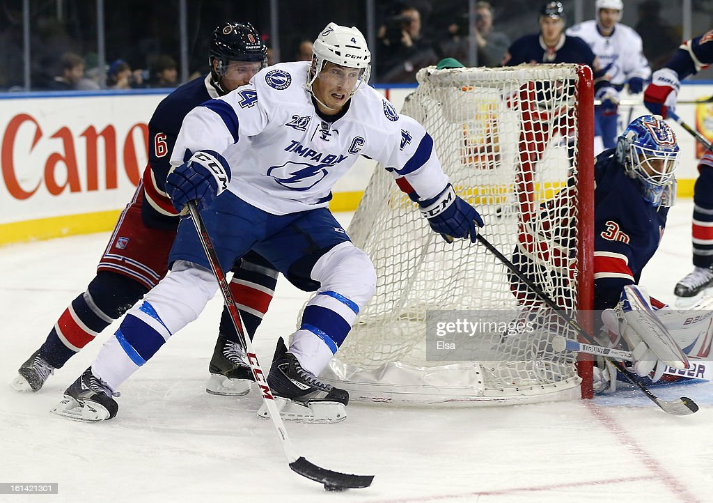 <a gi-track='captionPersonalityLinkClicked' href=/galleries/search?phrase=Vincent+Lecavalier&family=editorial&specificpeople=201915 ng-click='$event.stopPropagation()'>Vincent Lecavalier</a> #4 of the Tampa Bay Lightning wraps around the net as <a gi-track='captionPersonalityLinkClicked' href=/galleries/search?phrase=Anton+Stralman&family=editorial&specificpeople=2271901 ng-click='$event.stopPropagation()'>Anton Stralman</a> #6 of the New York Rangers defends on February 10, 2013 at Madison Square Garden in New York City.The New York Rangers defeated the Tampa Bay Lightning 5-1.