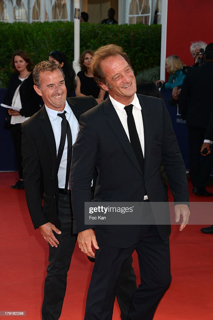 <a gi-track='captionPersonalityLinkClicked' href=/galleries/search?phrase=Vincent+Lindon&family=editorial&specificpeople=626589 ng-click='$event.stopPropagation()'>Vincent Lindon</a> (R) and Christophe Dechavanne attend the 'Blue Jasmine' Premiere at the 39th Deauville Film Festival at the CID on August 31, 2013 in Deauville, France.