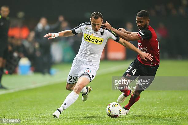 Vincent Manceau of Angers and Marcus Coco of Guingamp during the Ligue 1 match between Guingamp and Angers at Stade du Roudourou on October 29 2016...