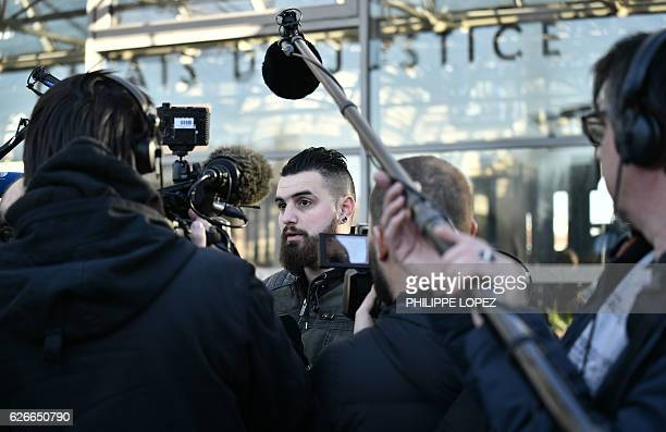 Vincent Martinez one the defendants speaks to press after three former Air France employees on trial for ripping company executives' shirts during a...