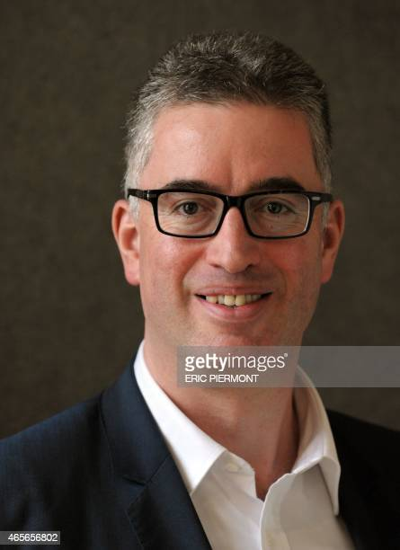Vincent Mignot General Director for France of French international retail group Auchan poses prior to the presentation of the group's 2014 results in...
