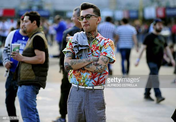 Vincent Monster the lead singer of the Mexican rockabilly band 'Rebel Cats' poses during the Mexican musicial festival Vive Latino at the Foro Sol in...