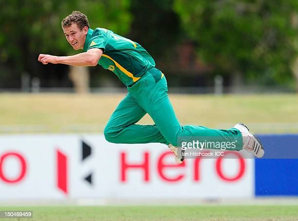 Vincent Moore of South Africa bowls during the ICC U19 Cricket World Cup 2012 Quarter Final match between England and South Africa at Tony Ireland...