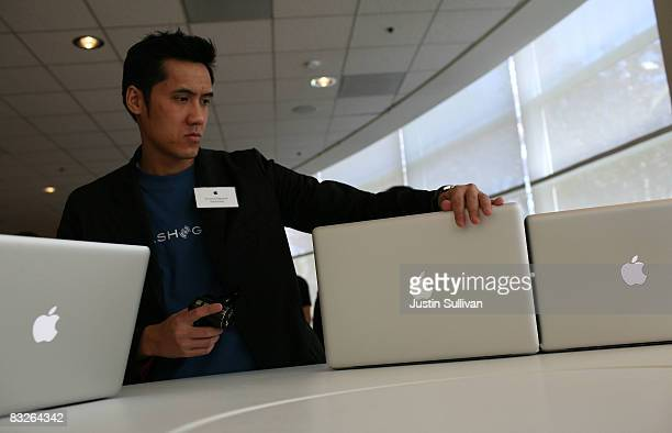 Vincent Nguyen inspects the new MacBook and MacBook Pro laptops after a special announcement event at Apple Headquarters October 14 2008 in Cupertino...