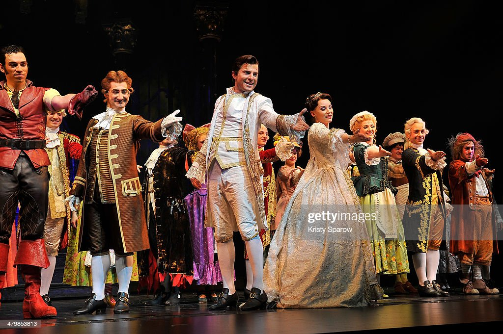 Vincent Niclo and Manon Taris take a bow onstage with the full cast of 'The Beauty And The Beast' during the premiere at Theatre Mogador on March 20...