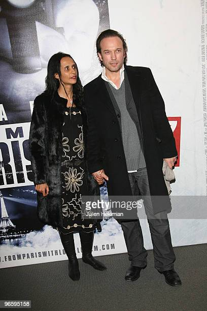 Vincent Perez and his wife Karine Silla attend 'From Paris with Love' Paris premiere at Cinema UGC Normandie on February 11 2010 in Paris France
