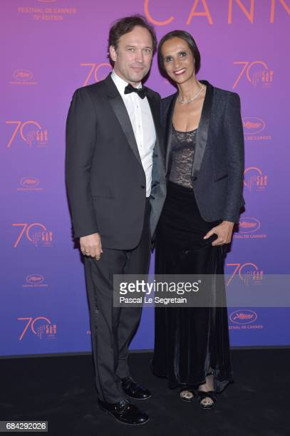 Vincent Perez and Karine Silla attend the Opening Gala dinner during the 70th annual Cannes Film Festival at Palais des Festivals on May 17 2017 in...