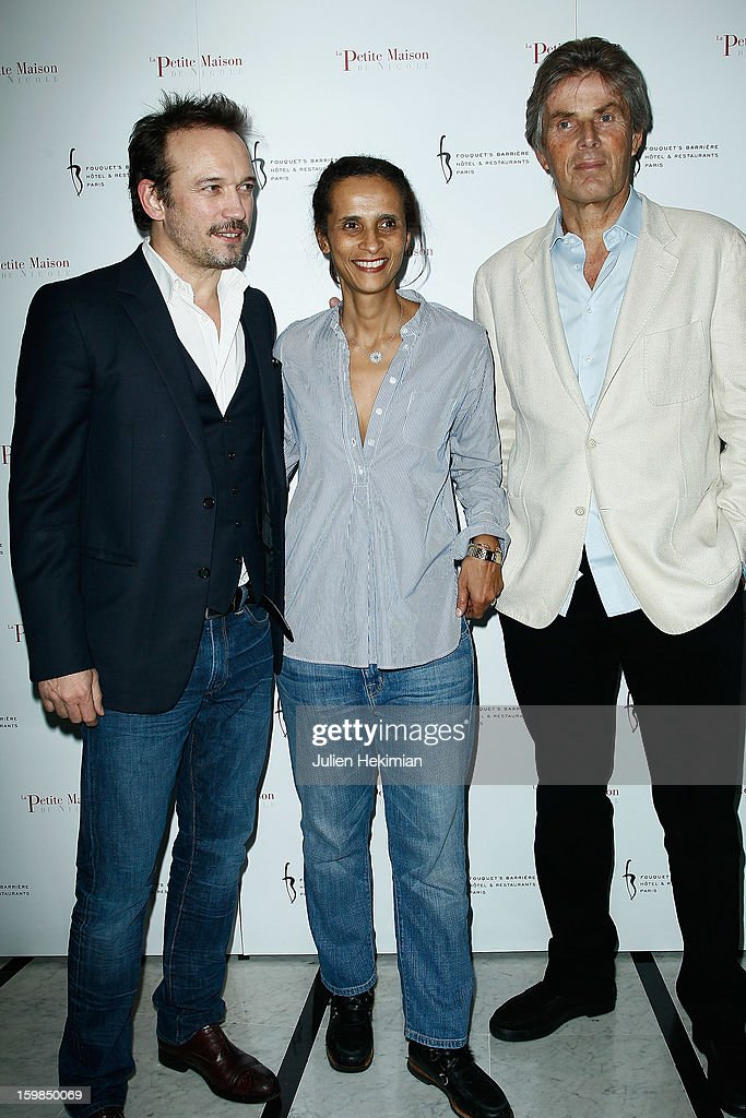 Vincent Perez, his wife Karine and Dominique Desseigne attend 'La Petite Maison De Nicole' Inauguration Photocall at Hotel Fouquet's Barriere on January 21, 2013 in Paris, France.