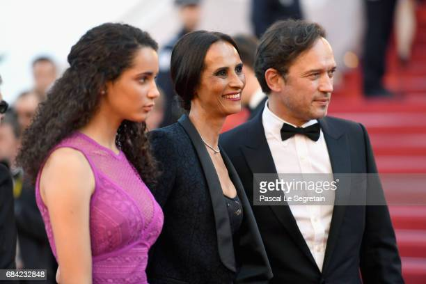 Vincent Perez Karine Silla and Iman Perez attend the 'Ismael's Ghosts ' screening and Opening Gala during the 70th annual Cannes Film Festival at...