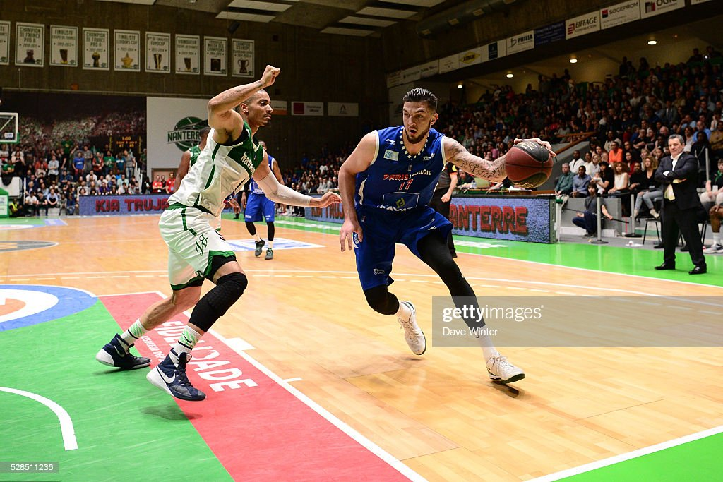 Vincent Poirier of Paris Levallois takes on Fernando Raposo of Nanterre during the basketball French Pro A League match between Nanterre and Paris Levallois on May 5, 2016 in Nanterre, France.