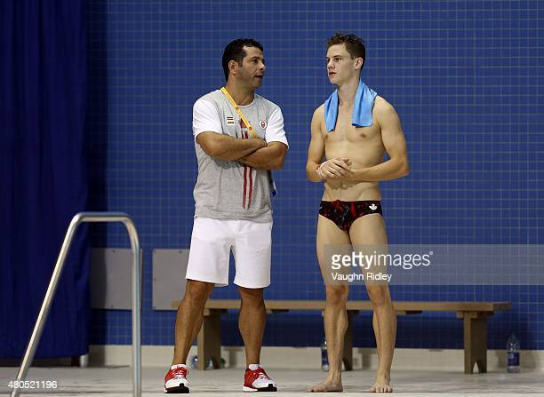 Vincent Riendeau of Canada speaks to his coach Arturo Miranda while competing in the Men's 10m Platform Prelims during the Toronto 2015 Pan Am Games...