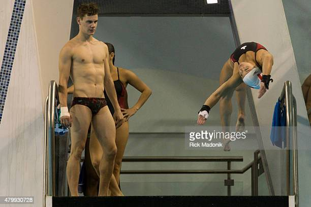 TORONTO JULY 8 2015 Vincent Riendeau watches as teammate Meaghan Benefito dives from the platform Team Canada diving team practices at the Pan Am...