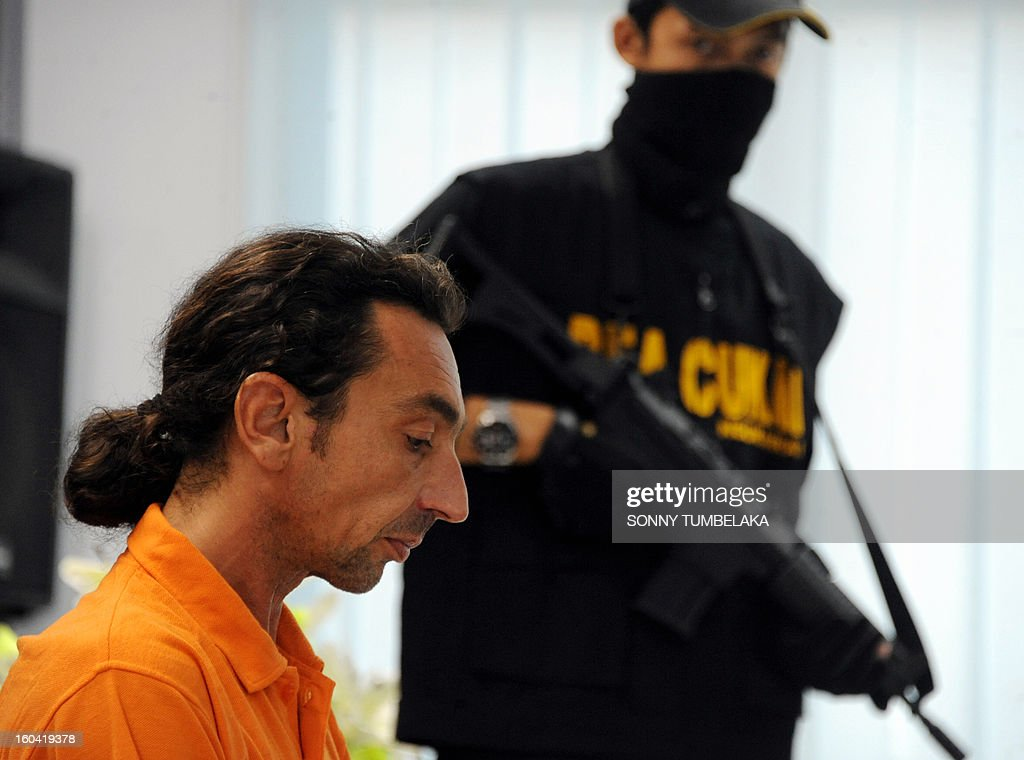 Vincent Roger Petrone of France (L) attends a press conference at customs office in Denpasar on Bali island on January 31, 2013. Petrone was arrested at Bali airport on January 29 for allegedly carrying four capsules of hashish, weighing 70 grams, at Bali International Airport in Indonesia, having arrived from Kuala Lumper. If convicted of smuggling the drugs into Indonesia, Petrone could face the death penalty, officials said.