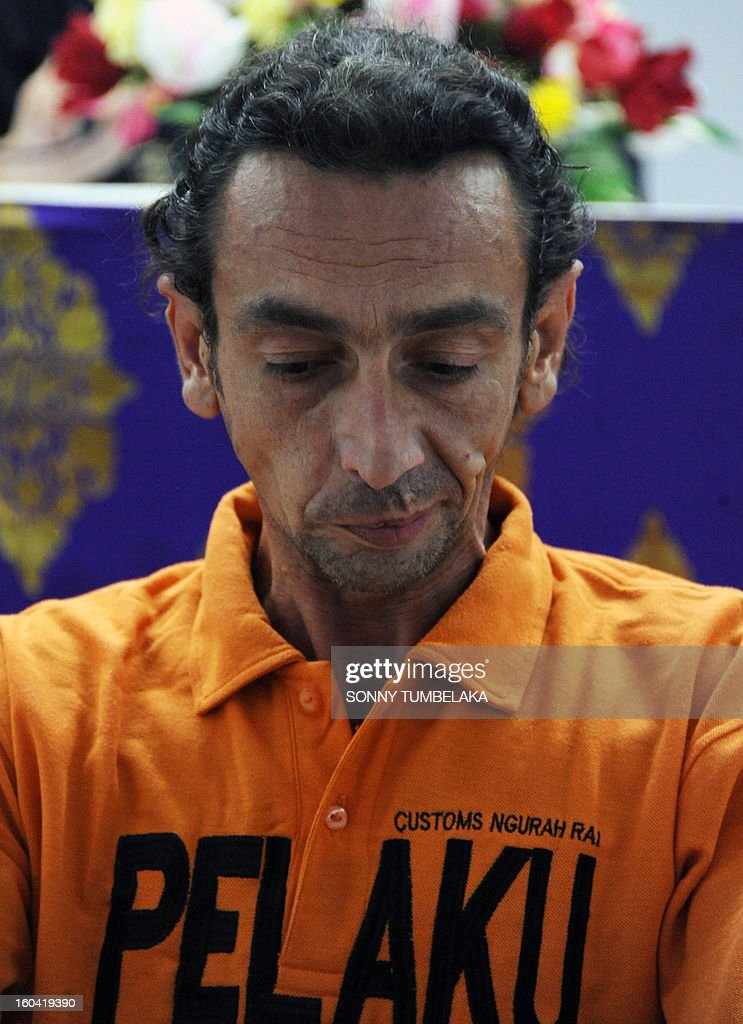 Vincent Roger Petrone of France looks on as he attends a press conference at a customs office in Denpasar on Bali island on January 31, 2013. Petrone was arrested at Bali airport on January 29 for allegedly carrying four capsules of hashish, weighing 70 grams, at Bali International Airport in Indonesia, having arrived from Kuala Lumper. If convicted of smuggling the drugs into Indonesia, Petrone could face the death penalty, officials said. AFP PHOTO / SONNY TUMBELAKA