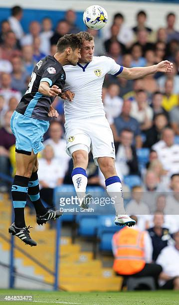Vincent Sasso of Sheffield Wednesday FC and Chris Wood of Leeds United FC during the Sky Bet Championship match between Leeds United and Sheffield...