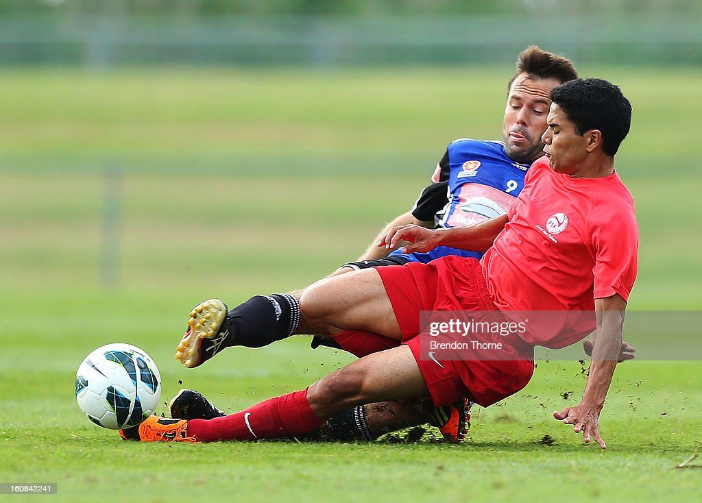 Vincent Simon of Tahiti competes with <a gi-track='captionPersonalityLinkClicked' href=/galleries/search?phrase=Paul+Reid+-+Australian+Soccer+Player&family=editorial&specificpeople=15312270 ng-click='$event.stopPropagation()'>Paul Reid</a> of Sydney during the friendly match between Sydney FC and Tahiti at Macquarie Uni on February 6, 2013 in Sydney, Australia.