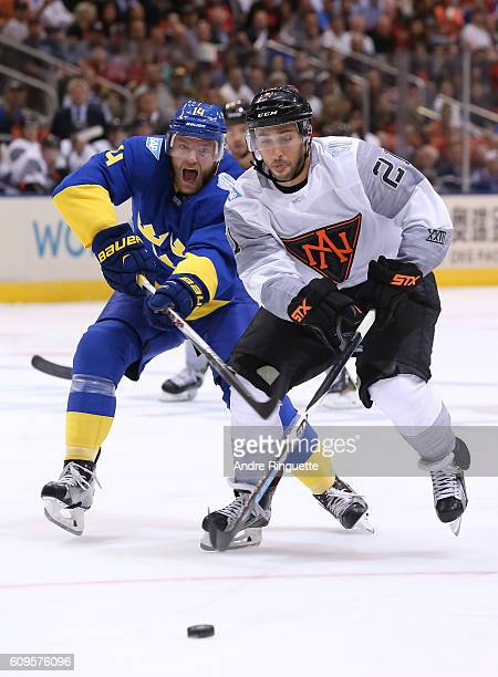 Vincent Trocheck of Team North America battles for a loose puck with Mattias Ekholm of Team Sweden during the World Cup of Hockey 2016 at Air Canada...