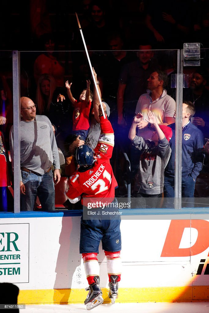 Vincent Trocheck #21 of the Florida Panthers gives a game stick to a fan after his shoot out goal for the win against the Dallas Stars at the BB&T Center on November 14, 2017 in Sunrise, Florida.
