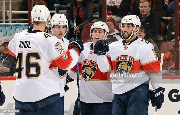 Vincent Trocheck of the Florida Panthers is congratulated by teammates Jakub Kindl Greg McKegg and Jonathan Marchessault after his first period goal...