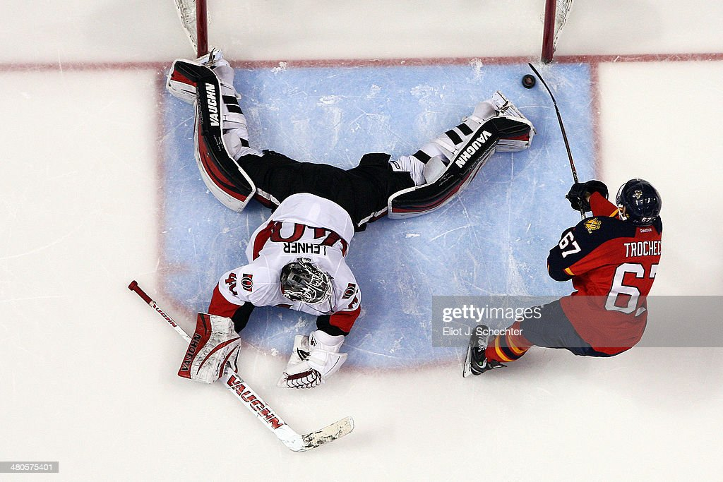Vincent Trocheck #67 of the Florida Panthers scores against goaltender <a gi-track='captionPersonalityLinkClicked' href=/galleries/search?phrase=Robin+Lehner&family=editorial&specificpeople=5894610 ng-click='$event.stopPropagation()'>Robin Lehner</a> #40 of the Ottawa Senators in a shoot out at the BB&T Center on March 25, 2014 in Sunrise, Florida.